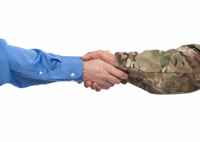 transitioning veteran shaking hands with employer
