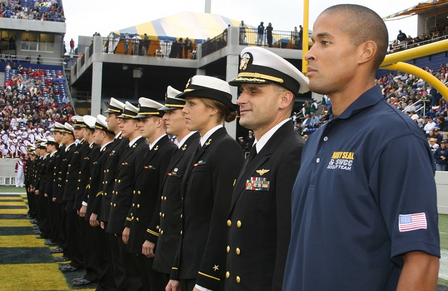 Chief Petty Officer David Goggins stands at attention with members of the U.S. Naval Academy's triathlon team