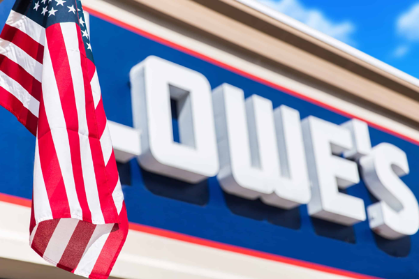 Lowe's building sign with a flag in the background