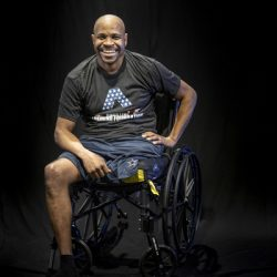 Keith Murphy sitting in wheelchair smiling