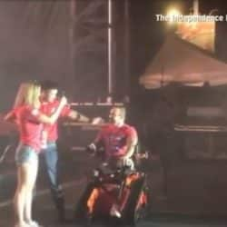 Toby Keith and wounded Marine in his new wheelchair onstage during concert