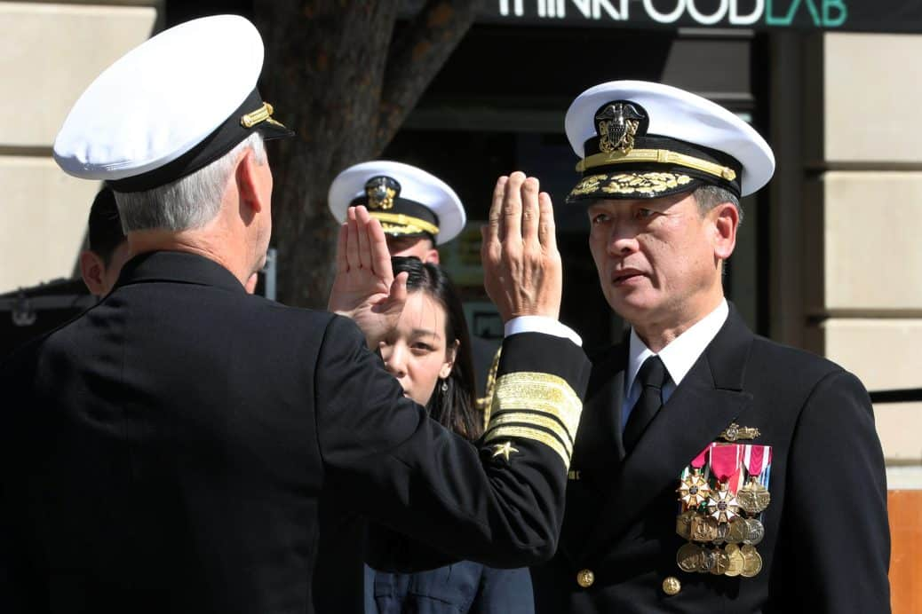 Vice Adm. Thomas J. Moore administers the oath of office to Rear Adm. Huan T. Nguyen during Nguyen's promotion ceremony at the U.S. Navy Memorial & Heritage Center, Oct. 10, 2019.