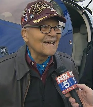 Veteran Charles McGee speaking in to Fox News microphone during Superbowl interview