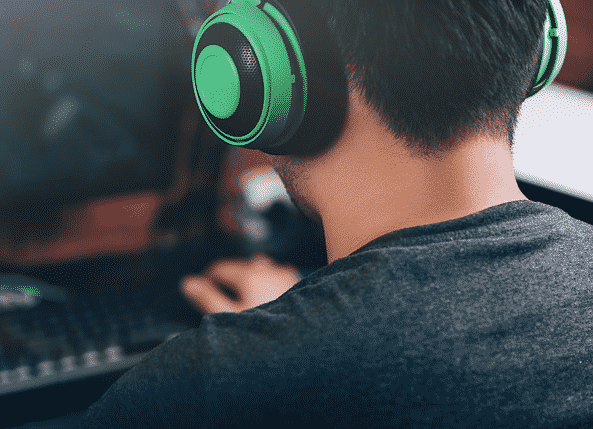man playing a video game headphones on