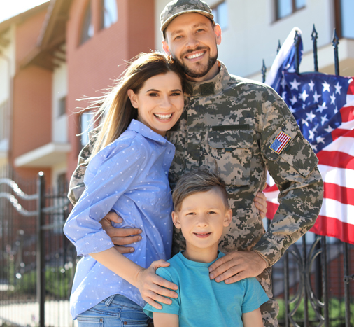 An American Soldier with his wife and young son, smiling for the camera
