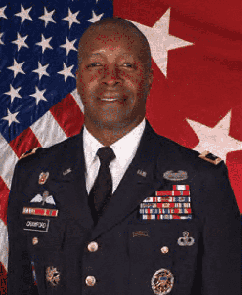 Army CIO Lieutenant General Bruce T. Crawford in uniform flag in background