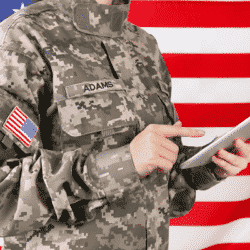 soldier in Army uniform with flag in background typing scrolling on iPad
