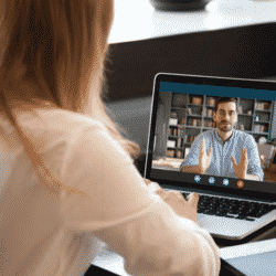 woman recruiter interviewing man during a virtual meeting online