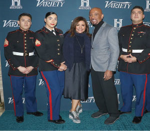TV personalities Rachael Ray and Montel Williams (C) pose with the 1st Marine Corps District at the 2nd Annual Variety Salute to Service in New York City.