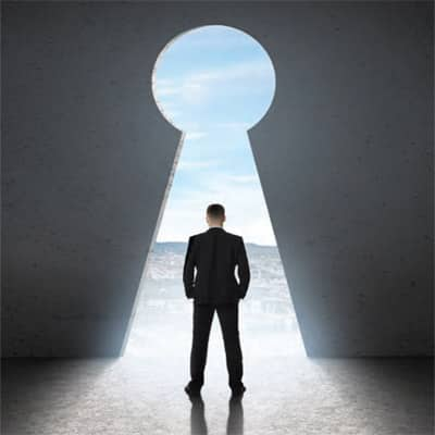 An illustration of a man in a suit standing in front of a large key hole shaped entrance