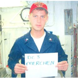 William Merchen holding sign in hand that says his name and D-3