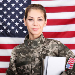 Female soldier with books on USA flag background