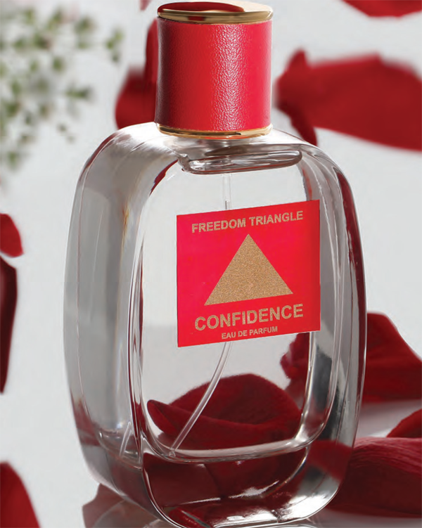 bottle of triangle fragrance surrounded by rose petals