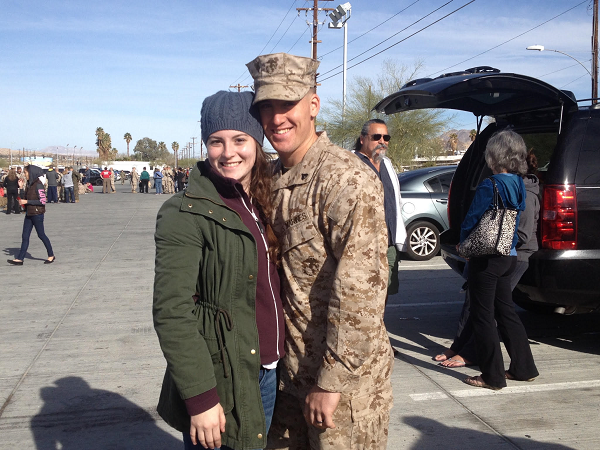 Cody Baerman pictured with his wife in him fatigues