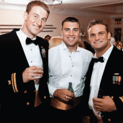 Ben Biles and Keith Lisante at friends wedding smiling wearing military dress uniform