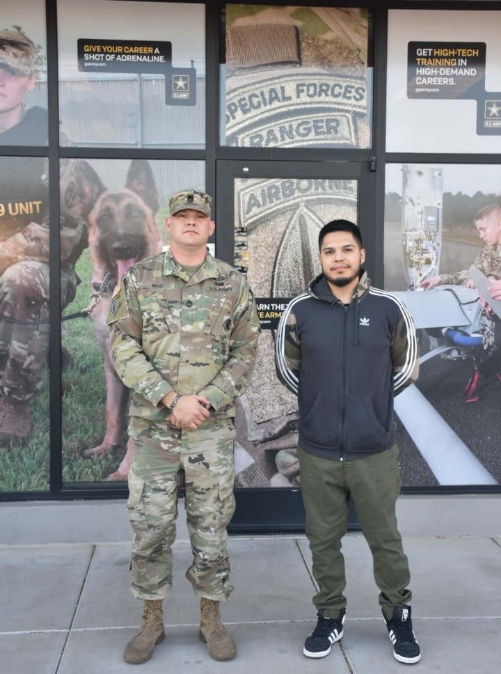 Future U.S. Army Soldier Kenny Oliver (right), poses with his recruiter