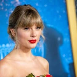 Taylor Swift closeup with her smiling wearing red lipstick