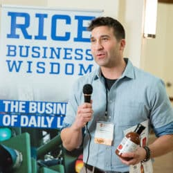 man with microphone pitching his business idea