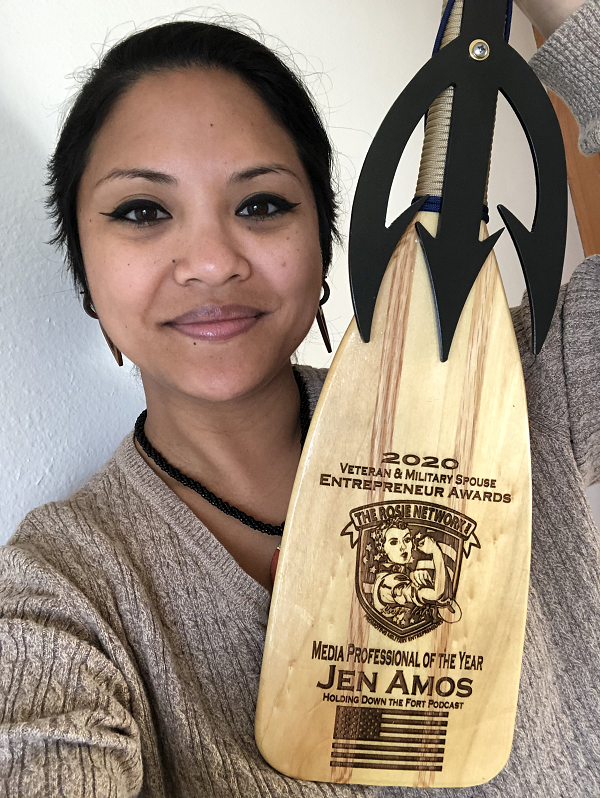 Jen Amos holding the 2020 National Veteran & Military Spouse Entrepreneur Award, a Navy Paddle hand crafted by Valhallas Forge