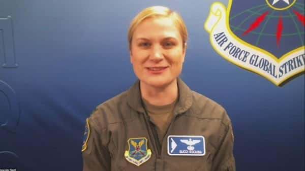 Sarah the female bomber pilot close up image of her in military uniform smiling