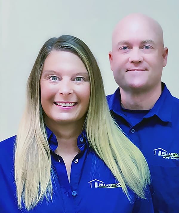 Lori and Dave Starnes closeup wearing blue work uniform