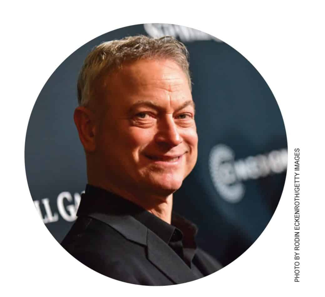 Gary Sinise headshot looking over to the right smiling