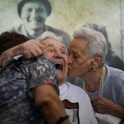 Martin Adler receives kiss on cheek from woman he saved